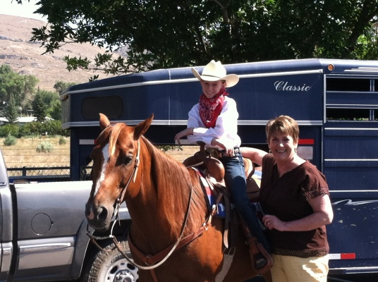 Karole's Masseuse Krickett's granddaughter, in 4H riding in the parade in Arco, Idaho